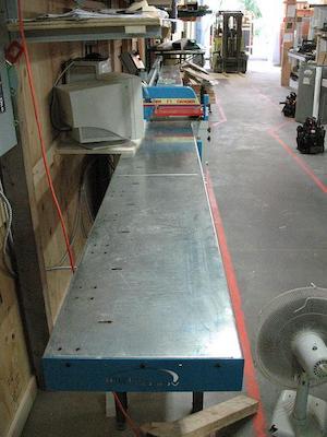 Ébouteuse automatisée pour la fabrication de portes et fenêtres   Automated cut off saw for window and door manufacturing